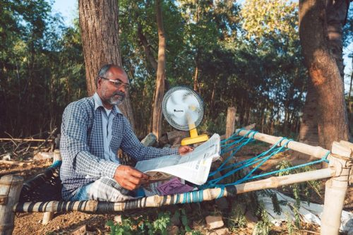 Sun King portable solar powered fan in action in rural India