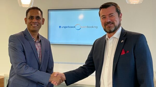 Manish Chandak and Steve Mackenzie during the signing of the merger between Ungerboeck, and EventBooking.